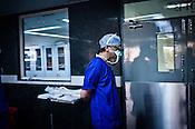58 year old heart surgeon, Dr. Devi Prasad Shetty leaves the OT after an operation at the Narayana Hrudayalaya in Bangalore, Karnataka, India. Photo: Sanjit Das/Panos