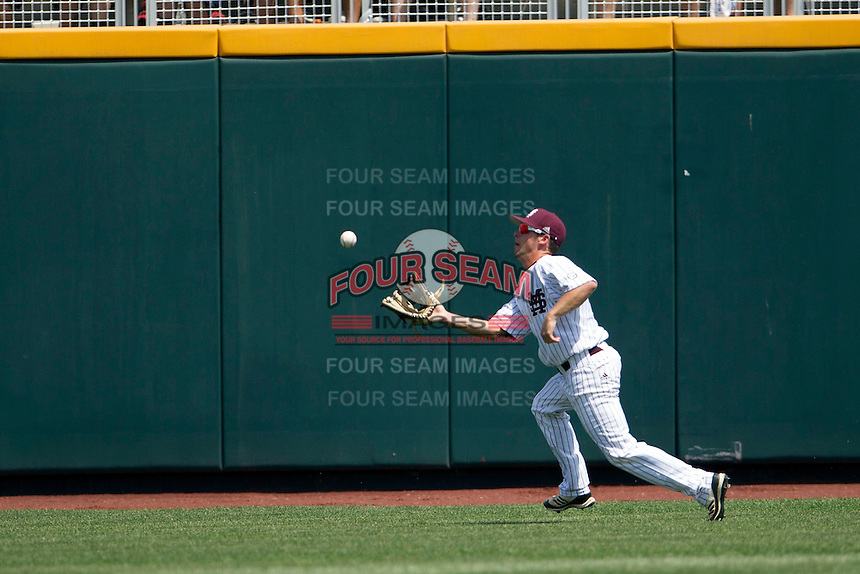 Mississippi State outfielder CT Bradford (10) makes a running catch during Game 11 of the 2013 Men's College World Series against the Oregon State Beavers on June 21, 2013 at TD Ameritrade Park in Omaha, Nebraska. The Bulldogs defeated the Beavers 4-1, to reach the CWS Final and eliminating Oregon State from the tournament. (Andrew Woolley/Four Seam Images)