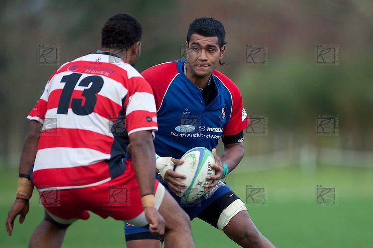 Sikeli Nabou looks to cut back inside Seremaia Tagicakibau. Counties Manukau Premier Club Rugby game between Ardmore Marist and Karaka played at Bruce Pulman Park Papakura on Saturday June 11th 2011. Karaka won 42 - 25 after leading 21 - 18 at the break.