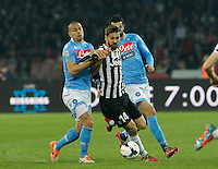 Gokhan Inler  Ferdinando Llorente    in action during the Italian Serie A soccer match between SSC Napoli and Juventus FC   at San Paolo stadium in Naples, March 30 , 2014