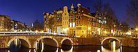 Illuminated canal bridges at night, Amsterdam, Netherlands<br />