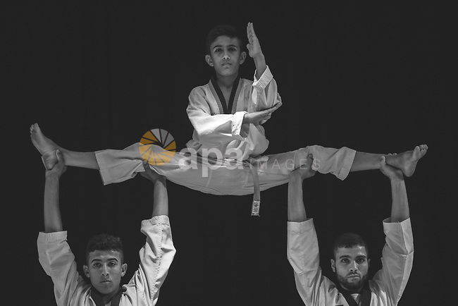 Boys show their skills in karate. Photo by Sanad Ltefa