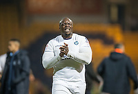 Winning goalscorer Adebayo Akinfenwa of Wycombe Wanderers after the final whistle during the The Checkatrade Trophy  Quarter Final match between Mansfield Town and Wycombe Wanderers at the One Call Stadium, Mansfield, England on 24 January 2017. Photo by Andy Rowland.