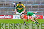 Michael Brennan shakes off Limerick's Mike Fitzgerald in the Munster Junior Championship Semi final held in the Gaelic Grounds last Saturday.