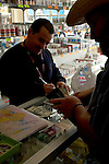 Tourist purchasing prescription medication at a pharmacy in Los Algodones, B.C, Mexico.