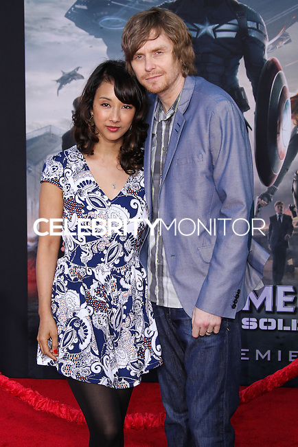 "HOLLYWOOD, LOS ANGELES, CA, USA - MARCH 13: Maurissa Tancharoen, Jed Whedon at the World Premiere Of Marvel's ""Captain America: The Winter Soldier"" held at the El Capitan Theatre on March 13, 2014 in Hollywood, Los Angeles, California, United States. (Photo by Xavier Collin/Celebrity Monitor)"