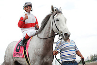 Hit It Rich ridden by jockey Javier Castellano give the thumbs up and head into the winners circle after winning the Orchid Stakes (G3T). Gulfstream Park Hallandale Beach Florida. 03-31-2012. Arron Haggart / Eclipse Sportswire