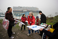 Cruise ship passengers greeted by souvenir sellers as they come ashore from Yangtze River Cruise, Fengdu, China