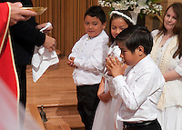 May 23, 2010 - St. Sebastian School, Los Angeles First Holy Catholic Communion.  Mr. Ed Hermendo Principal.  Fr. German Sanchez Celebrating Mass