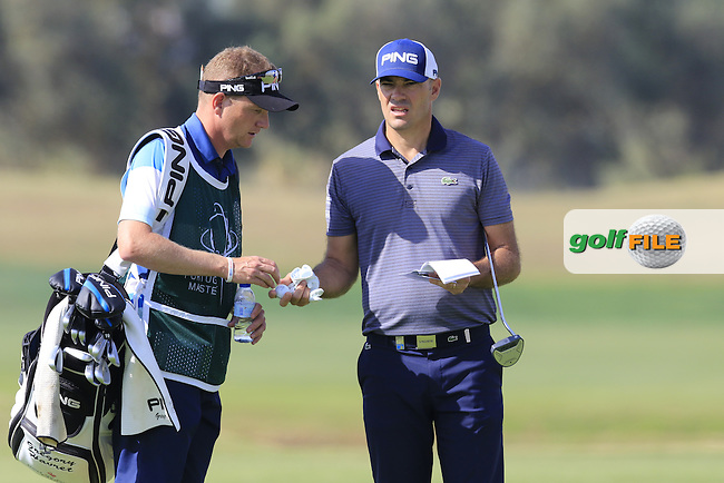 Gregory Havret (FRA) and caddy Basile on the 12th green during Thursday's Round 1 of the 2016 Portugal Masters held at the Oceanico Victoria Golf Course, Vilamoura, Algarve, Portugal. 19th October 2016.<br /> Picture: Eoin Clarke | Golffile<br /> <br /> <br /> All photos usage must carry mandatory copyright credit (&copy; Golffile | Eoin Clarke)