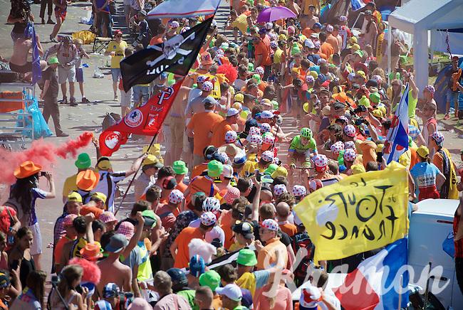 football-stadium or road race? Experiencing the craziness at the Dutch Corner (nr7) up Alpe d'Huez<br /> <br /> stage 20: Modane Valfréjus - Alpe d'Huez (111km)<br /> 2015 Tour de France