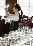Server Jessica Deal (cq), shines up one of the many wine glasses that will be used during the Chef Showcase Dinner at the Game Creek Club restaurant during the Taste of Vail in Vail on April 12, 2007.  (ELLEN JASKOL/ROCKY MOUNTAIN NEWS).***Jessica Deal(cq)