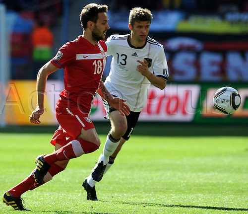 Germany's Thomas M¸ller (R) vies for the ball with Serbia's Milos Ninkovic during the 2010 FIFA World Cup group D match between Germany and Serbia at Nelson Mandela Bay Stadium in Port Elizabeth, South Africa 18 June 2010.