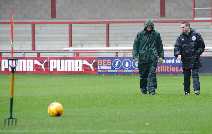 Referee Ross Joyce, right, speaks to the ground staff as he inspects the pitch at Fleetwood Town around 12.30<br /> <br /> Photographer Chris Vaughan/CameraSport<br /> <br /> Football - The Football League Sky Bet League One - Fleetwood Town v Scunthorpe United  - Saturday 20th February 2016 - Highbury Stadium - Fleetwood    <br /> <br /> &copy; CameraSport - 43 Linden Ave. Countesthorpe. Leicester. England. LE8 5PG - Tel: +44 (0) 116 277 4147 - admin@camerasport.com - www.camerasport.com