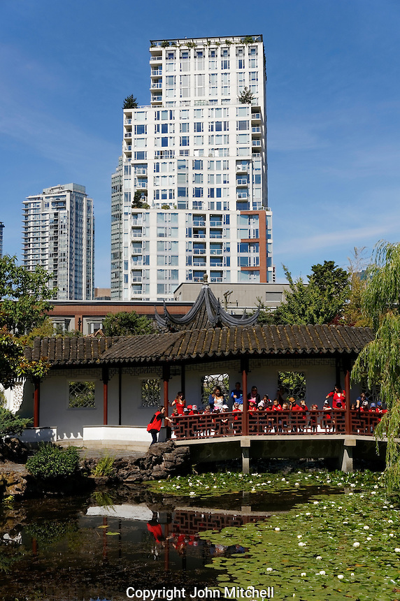 A group of young school children at Dr. Sun Yat-Sen Classical Chinese Garden, Chinatown, Vancouver, BC, Canada