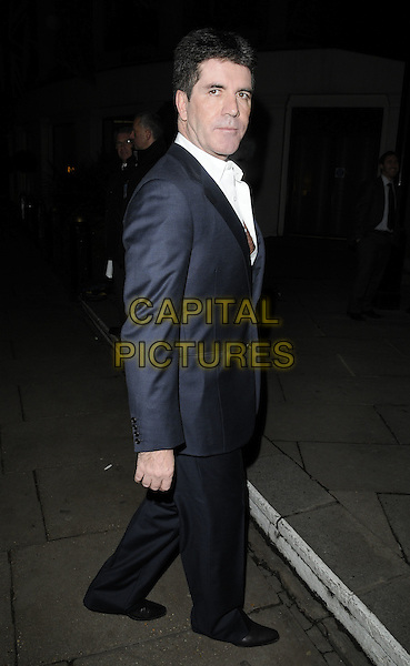 SIMON COWELL .At the Norwood Annual Dinner 2010, Grosvenor House Hotel, Park Lane, London, 15th November 2010..full length blue suit white shirt side grey gray .CAP/CAN.©Can Nguyen/Capital Pictures.