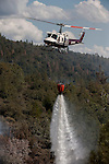 Helicopter drops water on hot spot on Montgomery Ridge, Division S, Old Yosemite Road, to protect the Greeley Hill community.