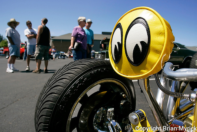 The headlight cover on this 1932 Ford 5 window coupe, owned by Ed Bearce, of Benton City, seems to be watching the people that are watching the cars during the annual Drive for Education car show fundraiser at Ellensburg High School, Saturday, July 21, 2012. (Brian Myrick / Daily Record)
