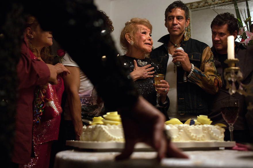 "July 7, 2012 – Mexico, Mexico City - Samantha celebrates her 80th birthday with close friends in Mexico City. Samantha Flores is an 80-year-old transgender woman from Veracruz, Mexico. She is a prominent social activist for LGBTQI rights and is the founder of the non-profit organization ""Laetus Vitae"", a day shelter for elderly gay people in Mexico City. Senior citizens in general are many times prone to neglect and abandonment by their families, leaving them all but invisible. Their plight can be even worse if they are homosexual. Photo credit: Bénédicte Desrus"