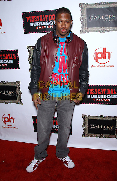 Nick Cannon.Carmen Electra performs live at Grand Opening of Pussycat Dolls Burlesque Saloon at Planet Hollywood Casino Resort, Las Vegas, Nevada, USA..June 4th, 2011.full length jeans denim black burgundy maroon leather jacket blue turquoise top headphones .CAP/ADM/MJT.© MJT/AdMedia/Capital Pictures.