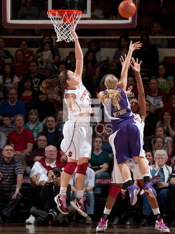 STANFORD, CA - February 12, 2011: Kayla Pedersen of the Stanford Cardinal women's basketball team stretches for a block while Nnemkadi Ogwumike draws the charge during Stanford's 62-52 win over Washington at Maples Pavilion.
