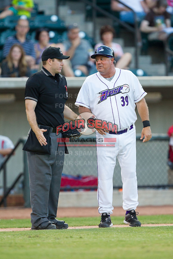 Winston-Salem Dash manager Tommy Thompson (39) discusses a call with home plate umpire Brian Peterson during the game against the Carolina Mudcats at BB&T Ballpark on June 6, 2014 in Winston-Salem, North Carolina.  The Mudcats defeated the Dash 3-1.  (Brian Westerholt/Four Seam Images)