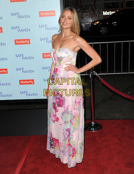 "Estella Warren.""Safe Haven"" Los Angeles Premiere held at the TCL Chinese Theatre, Hollywood, California, USA..February 5th, 2013      .full length pink purple floral print dress strapless hand on hip .CAP/DVS.©DVS/Capital Pictures."