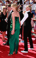 US talk show host Ellen Degeneres is with her girlfriend/fiance Portia De Rossi as she arrives at the 35th Annual Daytime Emmy Awards held at the Kodak Theatre in Los Angeles on June 20, 2008.