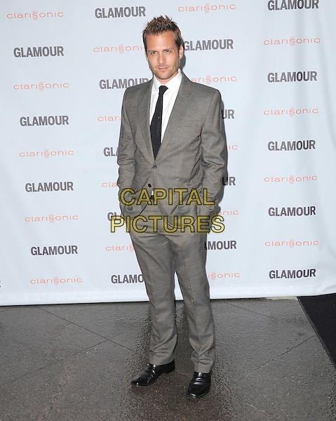 Gabriel Macht.The Glamour Reel Moments held at The Directors Guild of America in West Hollywood, California, USA..October 24th, 2011.full length black tie white shirt grey gray suit hands in pockets .CAP/RKE/DVS.©DVS/RockinExposures/Capital Pictures.
