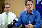 Republican presidential hopeful Tim Pawlenty, right, campaigns on Tuesday, July 26, 2011 in Washington, IA.