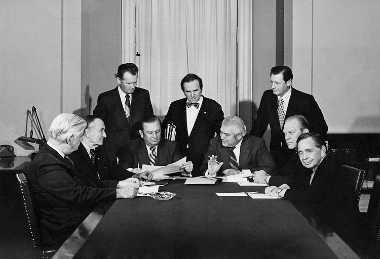 Thomas N. Gay. and Jos. E. O'Leary, Assistant Director, sitting with Chairman Sen. Howard Cannon, D-Nev., Sen. Mike Mansfield, D-Mont., Sen. Marlow Cook, R-Ky., Rep. Carl Albert, D-Okla., Rep. Tip O'Neill, D-Mass. and Vice President Gerald Ford, at a meeting. 1973. (Photo by CQ Roll Call)