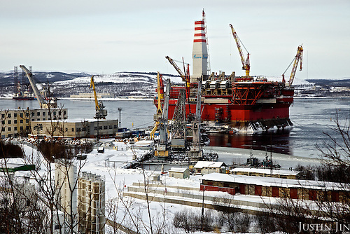 The ice-resistant Prirazlomnaya oil platform is being outfitted by Gazprom on the coast of Murmansk City before being towed to the Prirazlomnoye oil field in the eastern part of the Pechora Sea about 60 km north of the Nenets Autonomous Okrug. <br />This is the first Arctic-class oil platform in the world and the first commercial offshore development in the Arctic. <br /> <br /> The platform has been under construction at the Sevmash yard for 15 years and is designed to operate on Russia&rsquo;s first offshore hydrocarbon field in the Arctic, the Prirazlomnoye oil field which is located in the eastern part of the Pechora Sea about 60 km north of the Nenets Autonomous Okrug.<br /> <br /> The Prirazlomnaya platform will be operated by a crew of about 200 men working on two-week shifts. The field holds resources of up to 41 million tons and annual peak production is believed to amount to about six million tons. A total of 36 wells will be drilled on site by year 2019.<br /> <br /> The platform has a length and width of 126 meters, oil storage capacity of 136,000 cubic meters and a daily production capacity of 19,000 cubic meters. The topside of the platform is based on the &ldquo;Hutton&rdquo; platform, an installation previously operating in the North Sea and acquired by former license holder Sevmorneftegaz in 2002.