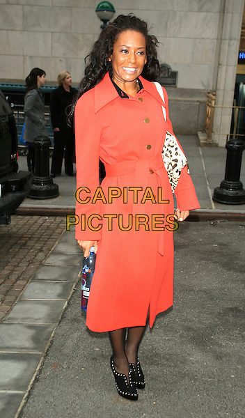 MELANIE BROWN aka MEL B .Rings the closing bell of the New York Stock Exchange.at the New York Stock Exchange, New York, NY, USA, February 2nd 2009..full length red orange coat black studded booties shoe boots leopard print bag scary spice belt belted .CAP/LNC.©LNC/Capital Pictures