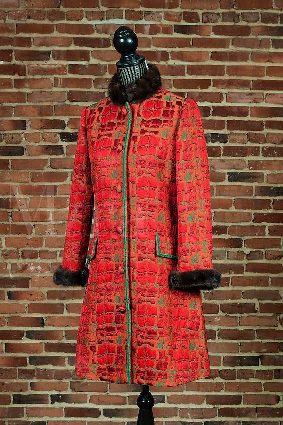 Woman's coat in a fashion design studio.