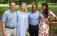 NWA Democrat-Gazette/CARIN SCHOPPMEYER Tony and Shelli Engle (from left) and Corey and Nicole Bender help support the Jones Center at the third annual Wine Walk on May 31 at Sassafras Springs Vineyard in Springdale.
