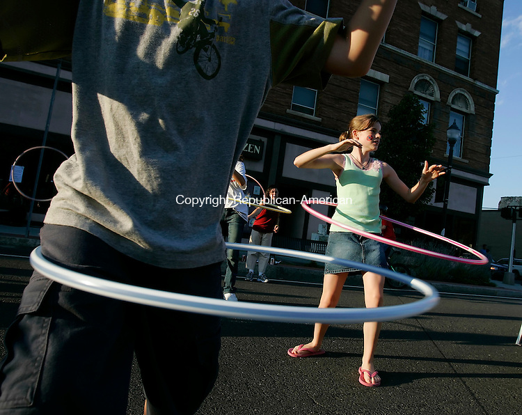 WINSTED,  CT 02 September 2005 -090105BZ02- Jessica Shotwell, 12, of Winsted, practices the hula hoop before a hula hoop contest during the 3rd Annual Main Street Block Party and Duck Race Friday afternoon.<br />  Jamison C. Bazinet / Republican-American
