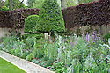 Laurent-Perrier Bicentenary Garden, designed by Arne Maynard, RHS Chelsea Flower Show 2012. Plants include: Centranthus lecoqii, Delphinium requeneii, Dicentra 'Burning Hearts', Hesperis matronalis var. albiflora, Persicaria bistorta 'Superba'