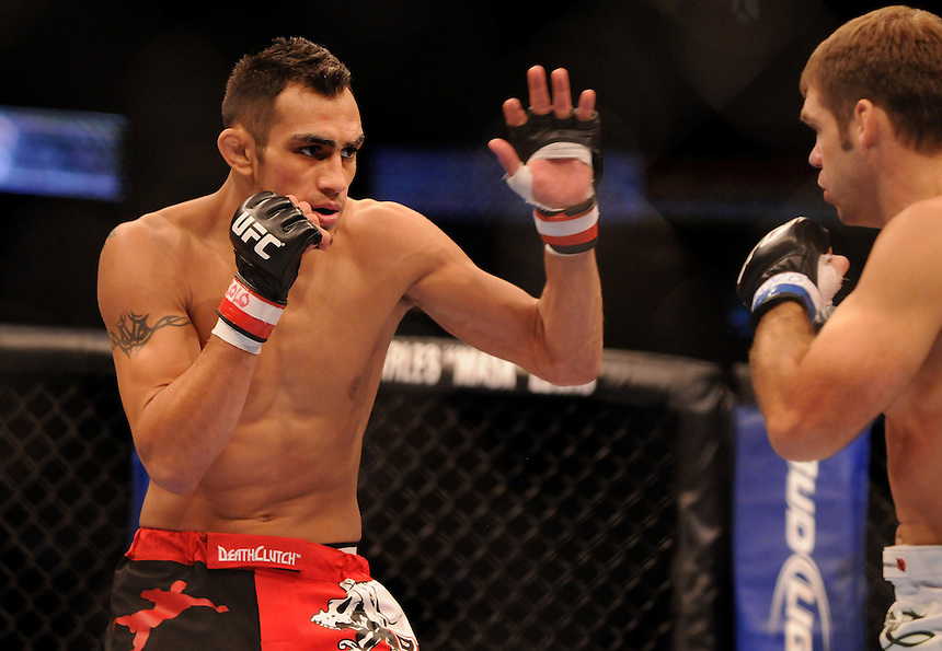 24 SEPTEMBER 2011:   Tony Ferguson in the octagon against Aaron Riley  during UFC 135 at the Pepsi Center in Denver, Colorado. *****For Editorial Use Only*****