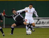DC United defender Facundo Erpen fights to keep control of the ball against CD Olimpia midfielder Jesus Alberto (25). DC United defeated CD Olimpia 3-2 to advance to the semi finals of the CONCACAF Champions' Cup. March 1, 2007 at RFK Stadium in Washington DC.
