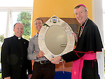 Principal of Slane National school Pat O'Donnell and Fr Joe Deegan present Bishop Denis Nulty with a mirror designed by local designer Lucy O'Gorman after he celebrated mass at the Church of St Patrick Slane. Photo:Colin Bell/pressphotos.ie