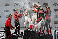 #99 JDC/Miller Motorsports ORECA 07, P: Stephen Simpson, Mikhail Goikhberg, #54 CORE autosport ORECA LMP2, P: Jon Bennett, Colin Braun, #31 Action Express Racing Cadillac DPi, P: Eric Curran, Felipe Nasr, podium, champagne