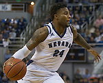 Nevada forward Jordan Caroline (24) drives against San Jose State in the first half of an NCAA college basketball game in Reno, Nev., Wednesday, Jan. 9, 2019. (AP Photo/Tom R. Smedes)