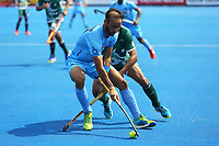 India's Ramandeep Singh shields the ball from Pakistan's Tasawar Abbas during the Hockey World League Semi-Final match between Pakistan and India at the Olympic Park, London, England on 18 June 2017. Photo by Steve McCarthy.