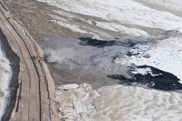 Tar Sands, March 2010. Suncor effluent pipe and tailings pond. Alberta Athabasca Tar Sands or Oil Sands.