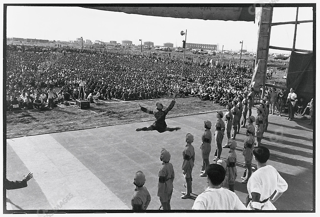 "A dancer flies in mid-air during a performance for peasants and workers of ""The Red Women Troop"" one of the eight ""model operas"" that were chosen by Mao's wife Jiang Qing. Each opera was intended as a lesson in the evils of the ""old society"" contrasted with the new ""realm of red virtue."" Daqing oil field; Heilongjiang Province, July 20, 1975"