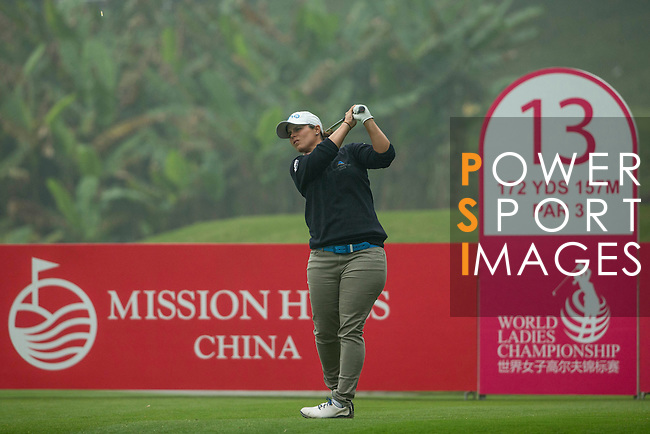 Valentine Derrey of France tees off at the 13th hole during Round 4 of the World Ladies Championship 2016 on 13 March 2016 at Mission Hills Olazabal Golf Course in Dongguan, China. Photo by Victor Fraile / Power Sport Images