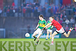 Jonathan Lyne of Kerry feels the pressure from Cork's Michael O'Leary in the Munster U21 Football Championship Final held on Wednesday night in Pairc Ui Rinn Cork.