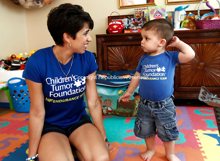 Southbury, CT- 27 June 2014-062714CM03-  Alex Santos Owens, 20 months old, of Southbury, plays with his mother, Diane Owens inside their home in Southbury on Friday. Alex who was born with neurofibromatosis, a genetic disorder inspired his mother to run a benefit half marathon next month in Chicago.  The race will help her raise money for the foundation that helps families of children with this disorder.   Christopher Massa Republican-American