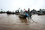 Boats gather at the Cai Rang floating market in the Mekong Delta, south of Can Tho, Vietnam. Sept. 30, 2011.