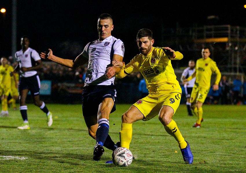 Fleetwood Town's Ched Evans battles with Guiseley's William Wells<br /> <br /> Photographer Alex Dodd/CameraSport<br /> <br /> The Emirates FA Cup Second Round - Guiseley v Fleetwood Town - Monday 3rd December 2018 - Nethermoor Park - Guiseley<br />  <br /> World Copyright © 2018 CameraSport. All rights reserved. 43 Linden Ave. Countesthorpe. Leicester. England. LE8 5PG - Tel: +44 (0) 116 277 4147 - admin@camerasport.com - www.camerasport.com